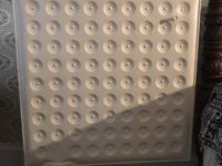 square shaped radiator on a stand with rows of circles