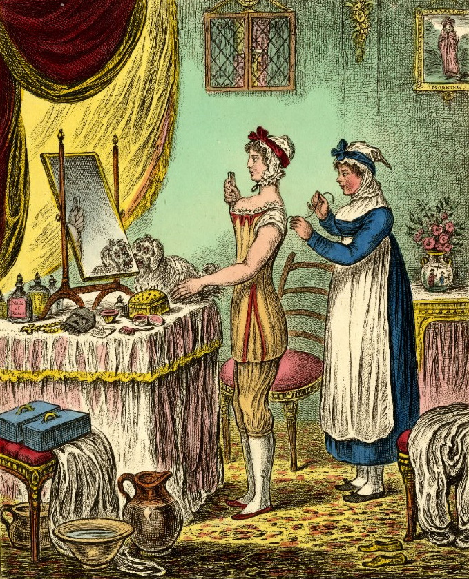 Illustration of a woman standing at a dressing table in undergarments getting laced into her corset by a maid.
