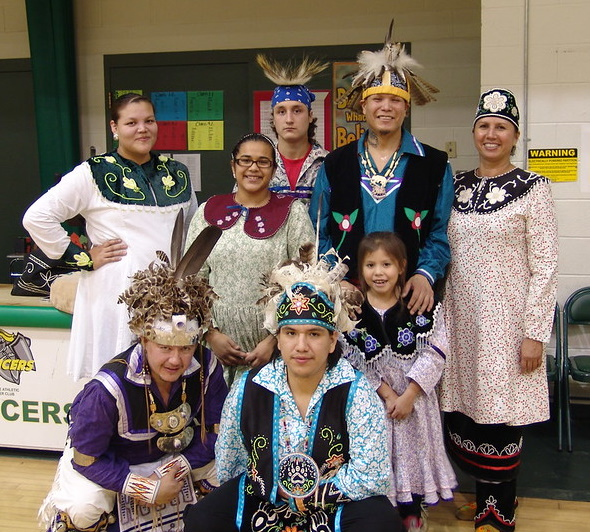 A group of young men and women in traditional Iroquois dress.