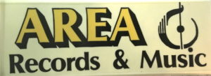 Rectangular sign that hung over the sidewalk from Area Records and Music on Seneca Stree