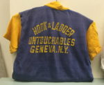 Blue and yellow t-shirt with back label Hook and Ladder Untouchables, Geneva, NY.