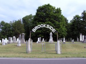 the gate into Brookside Cemetery from the opposite side of the road