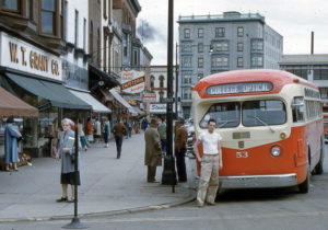 Man In White T Shirt In Front Of Bus May 1954