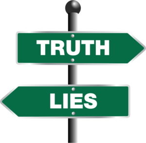 Two arrow street signs pointing in opposite directions labeled truth and lies.