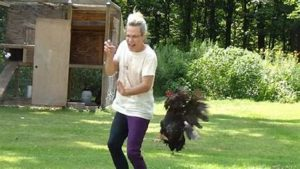 a person being chased by a chicken