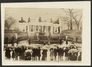 Female picketers outside the White House with general public watching
