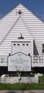 White Church With Mt. Olive Missionary Baptist Church Sign