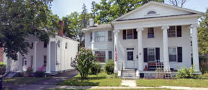 Two White Greek Revival Houses With Columns