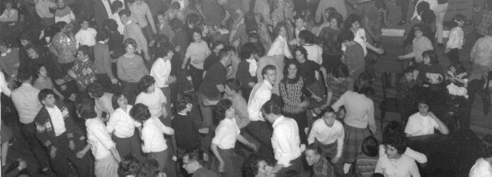 People dancing in front of a band