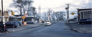 View of Lake Street to Lake with a diner, Firestone, and Texaco on the left and a Sunoco on the right.