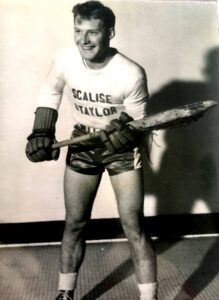 Young Man Posing With Lacrosse Sticke