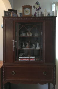 knicCChina cabinet filled with knacks and memorabilia