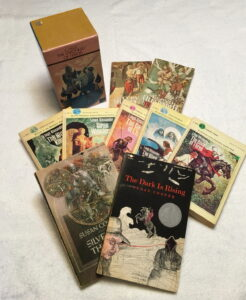 A collection of books by C.S. Lewis, Susan Cooper and Lloyd Alexander
