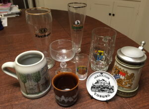 A collection of glassware from Germany (mugs, glasses, and beer steins)