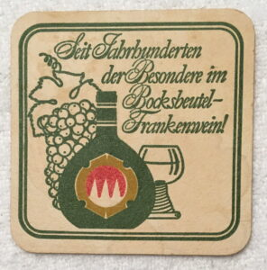 Coaster adverting Bocksbeutel wine in Germany