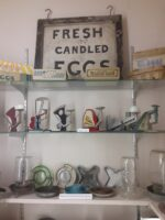 Various poultry paraphernalia displayed on shelves