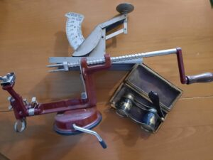 apple peeler, opera glasses, and the scale